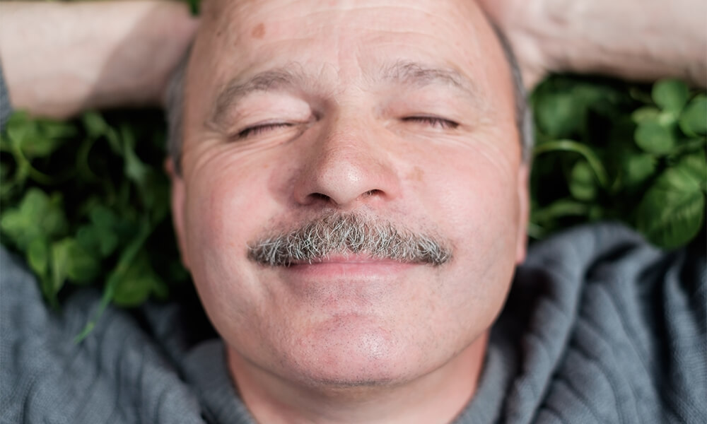 Man smiling after dialectical behavior therapy